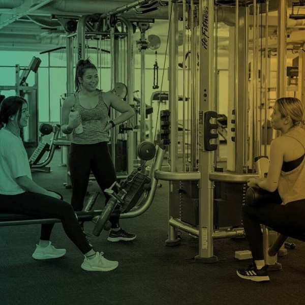 women enjoying a talk inside the gym